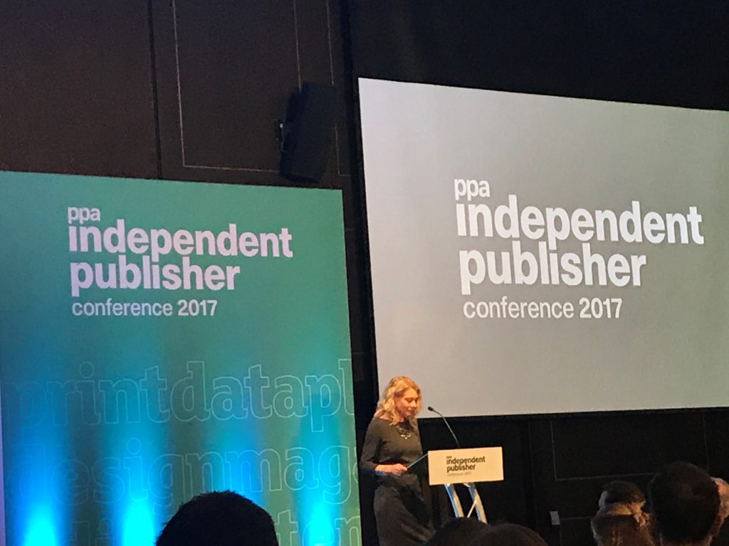 Speaker talking to audience in front of projection of PPA independent publisher conference 2017